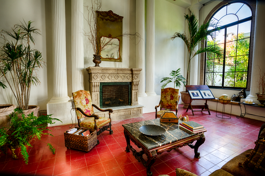 Unique Red Tile Floor Holds This Ornate Living Room Touched With Safari Details Like Greenery