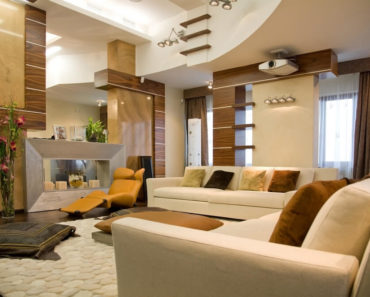Modern living room with soaring 2-story ceiling.