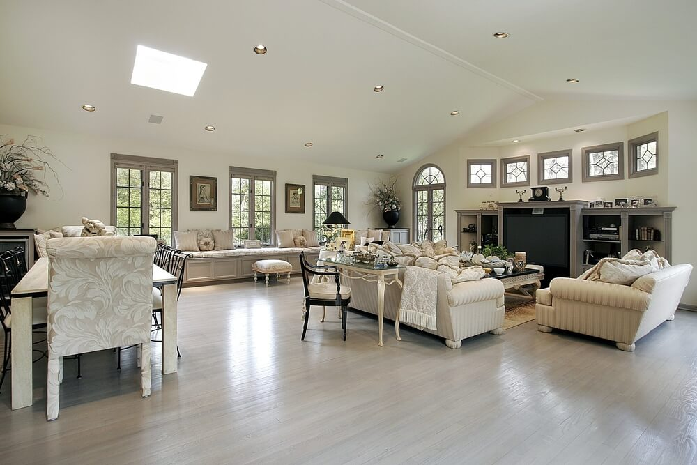 Wide Open Design Living Room Awash In Light Neutral Tones, With Vaulted  Ceiling Dotted With