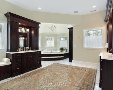 Custom luxury master bathroom with extensive custom woodwork throughout.