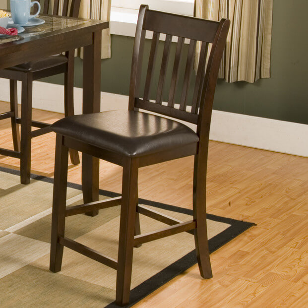Wooden counter stool with Mission-style back and cushioned seat.
