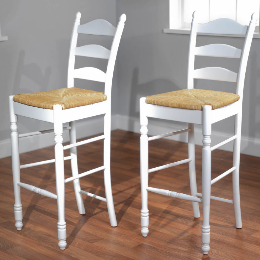 Paid of white ladder-back stools.