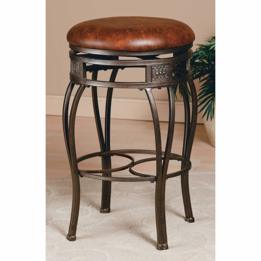 traditional backless stool with ornate legs and upholstered round seat