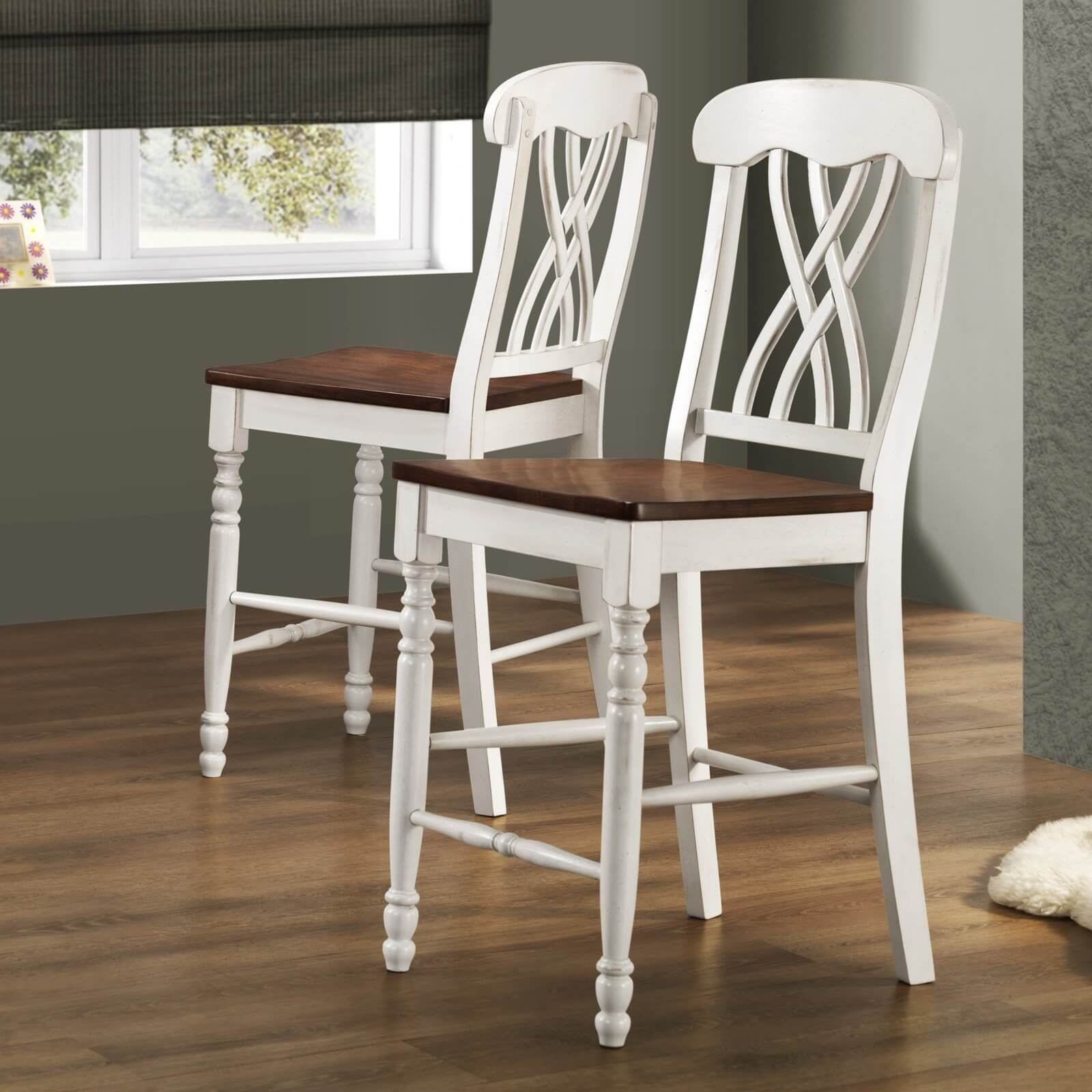 Pair of armless white cottage style stools with brown seats.