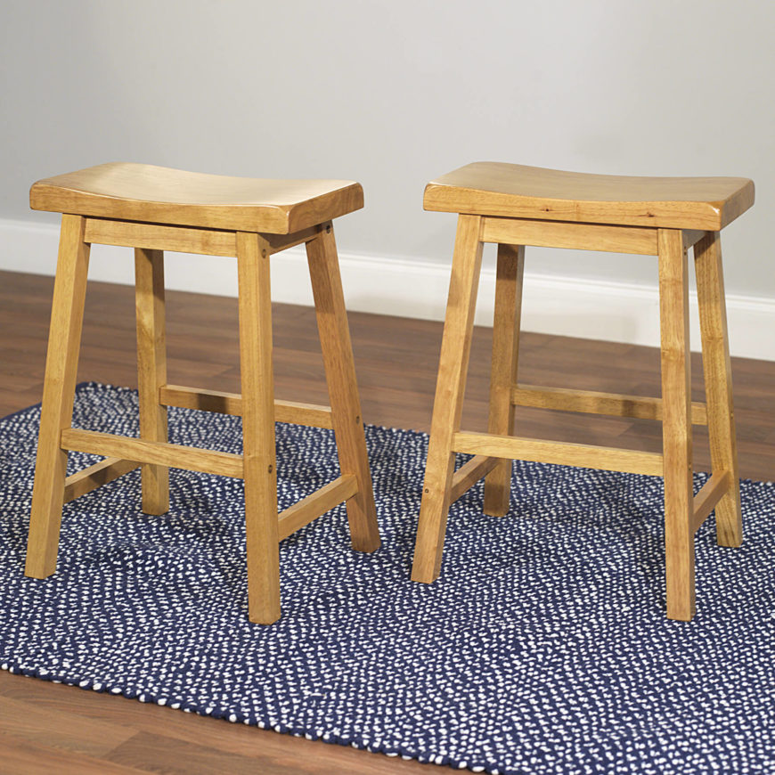 Pair of Scandinavian style wood saddle stools.