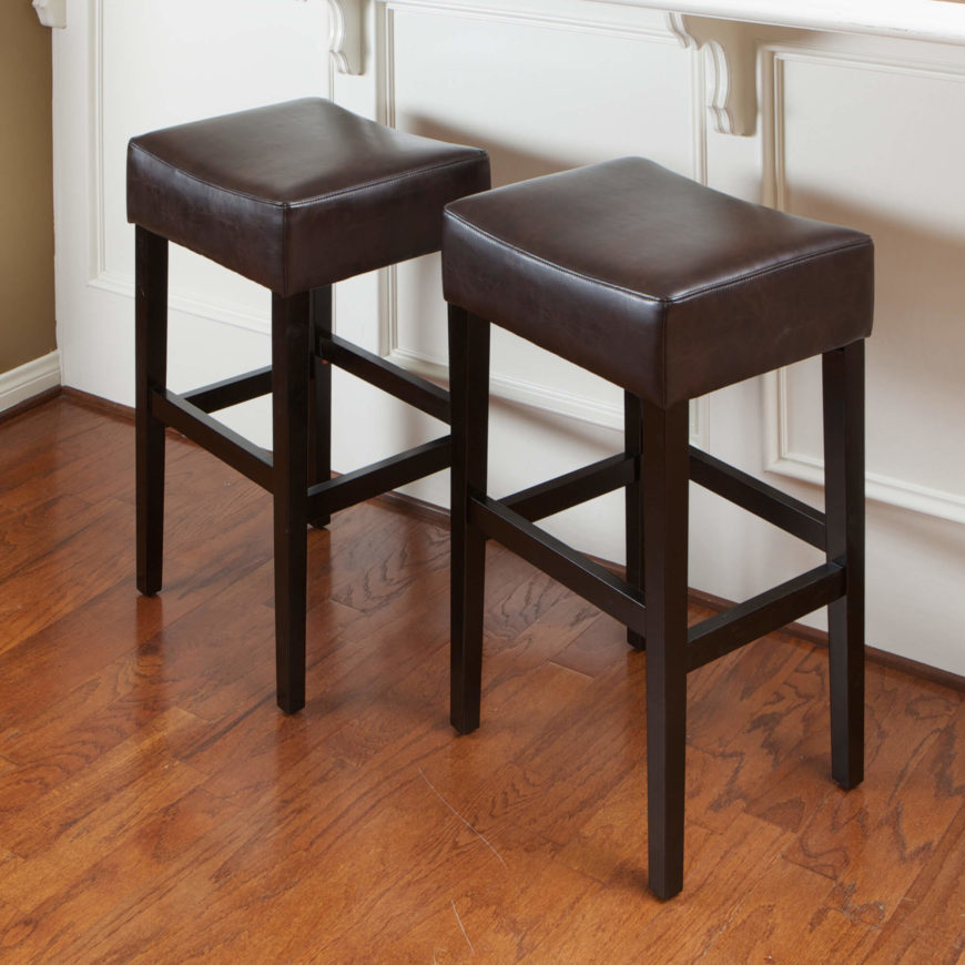 Backless leather-seat stools in the saddle-style with wooden legs. : saddle style counter stools - islam-shia.org