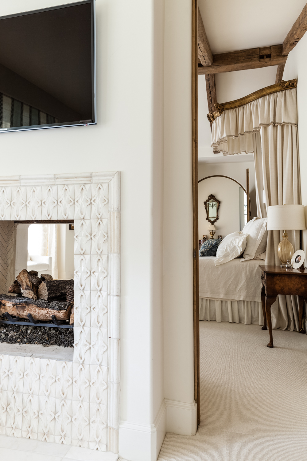 The bedroom fireplace is a pass-through model, enjoyed from both sides of the wall.