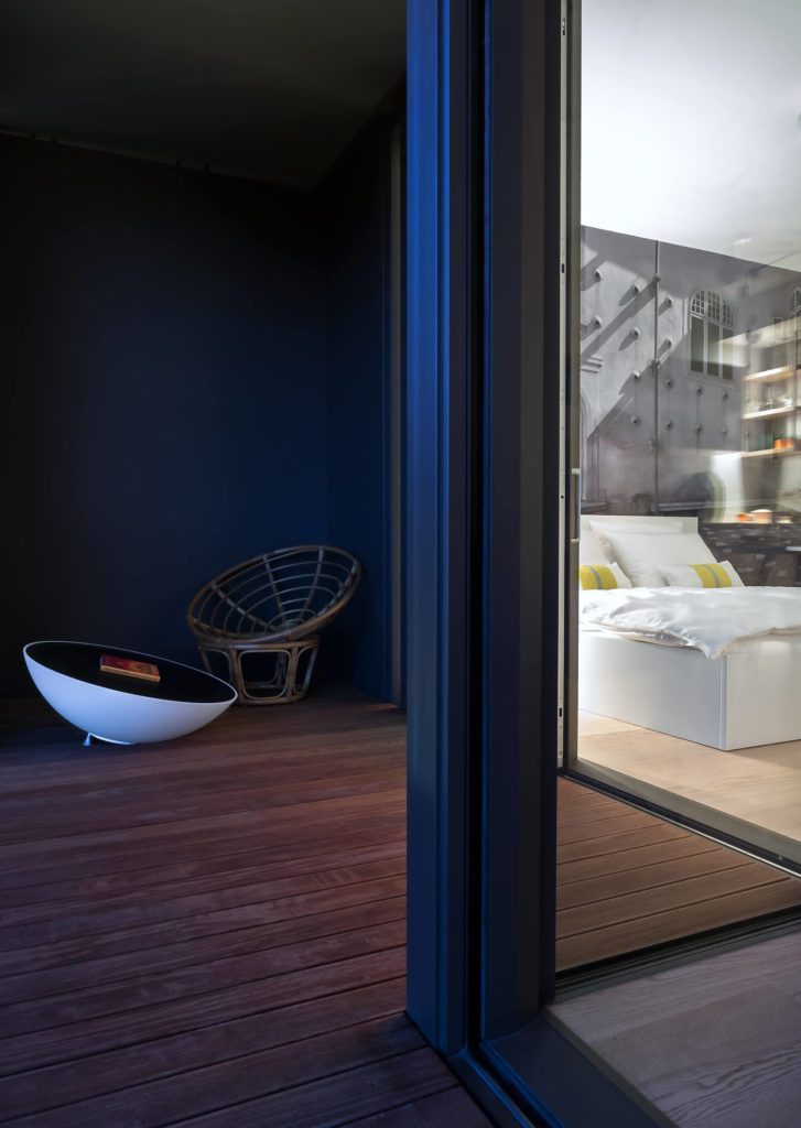 The patio widens next to the bedroom, allowing for a comfortable seating area.