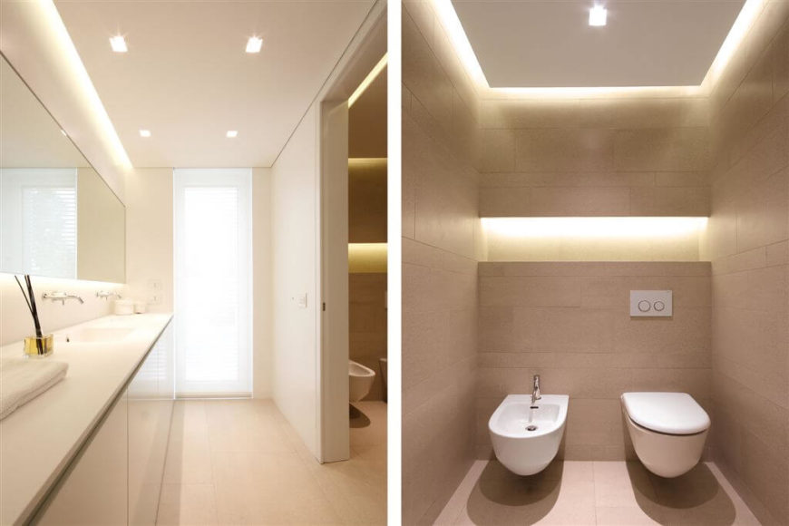 Bisected White Bathroom Design Fits A Room Length Vanity Across A Small  Doorway Separating The Shower
