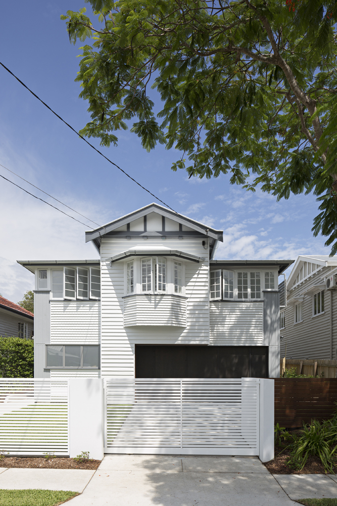 From the street, the home is unassumingly traditional in the Queenslander style, with a slatted gate wrapping the yard.