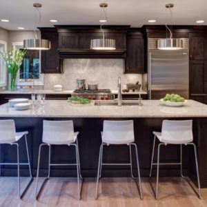 Contemporary kitchen with breakfast bar in small space by Drury Design