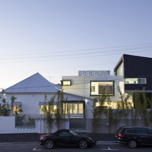 Modern addition to 19th century cottage by Base Architecture