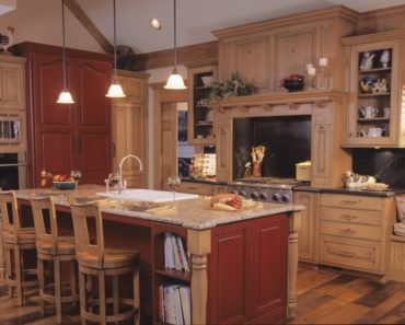 Rustic kitchen with plenty of light wood and red.