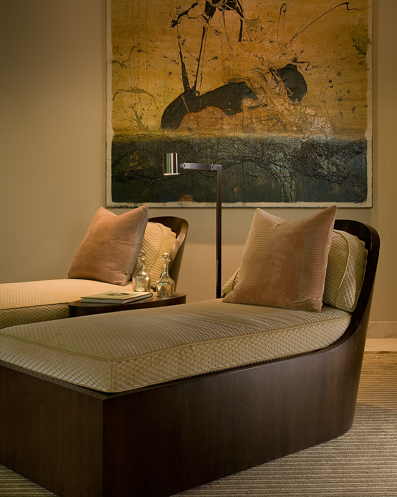The pair of dark wood crafted chaise lounge chairs are a custom design by Angelica Henry.