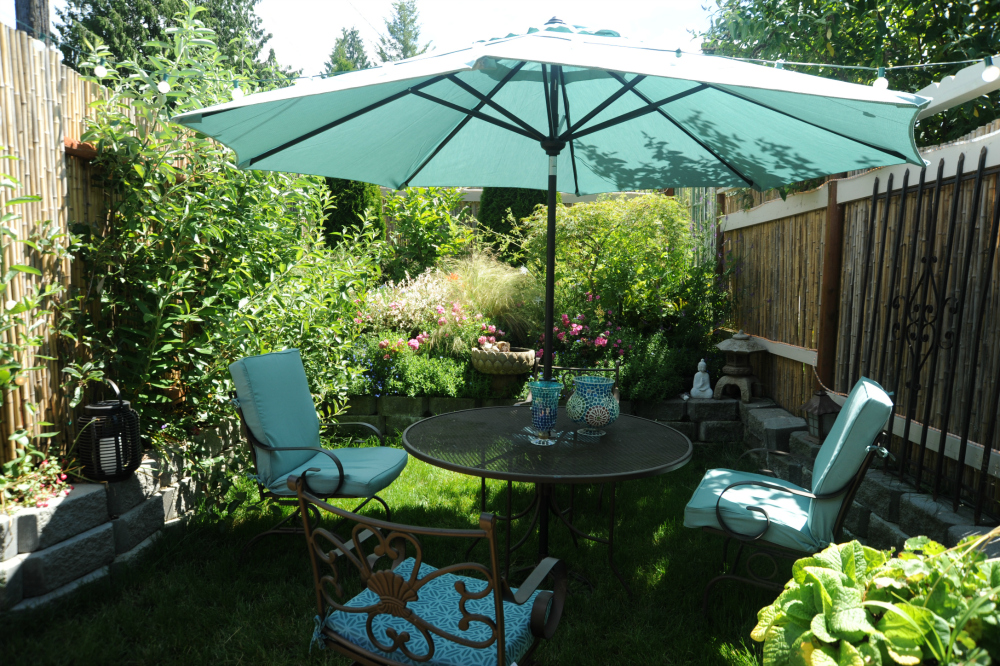 Patio dining area with large umbrella.