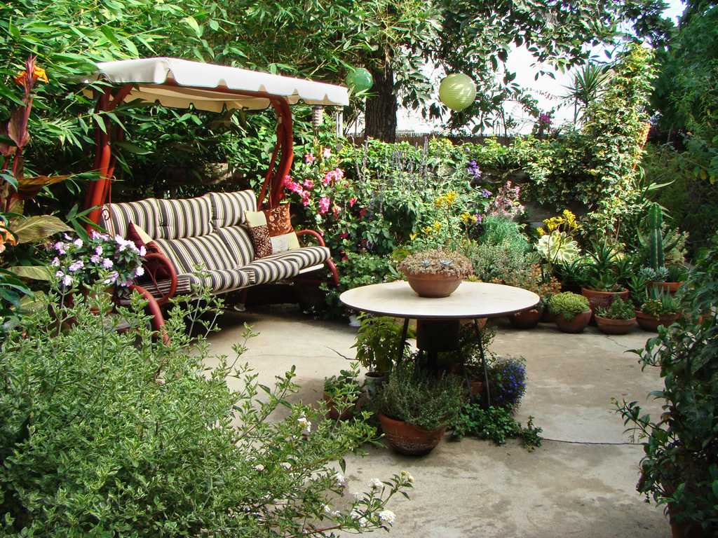 Patio surrounded by gardens.