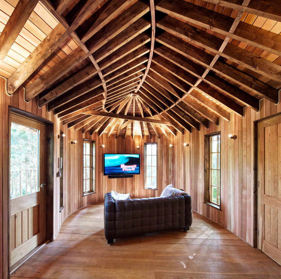 The gorgeous wood ribbing on the ceiling continues into the entertainment center, complete with a quilted sofa matching the one in the kitchenette.