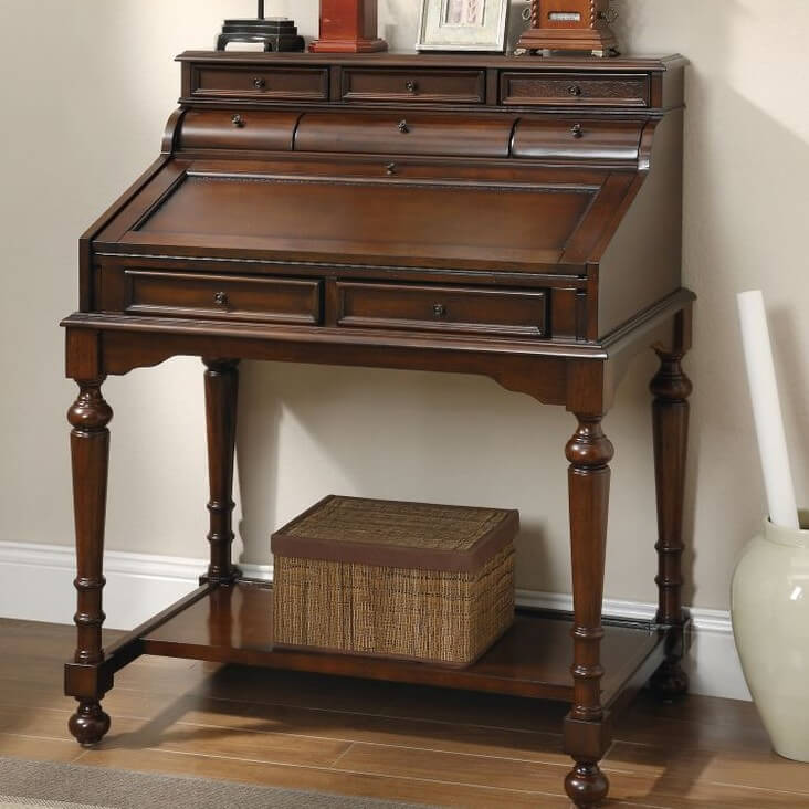 This is a type of desk topped by a hinged desktop surface, which is in turn topped by a bookcase, usually closed with doors or drawers. The whole is usually a single, tall and heavy piece of ornate furniture. There were originally for people who wanted a luxurious desk yet lacked the room for a formal roll-top model.