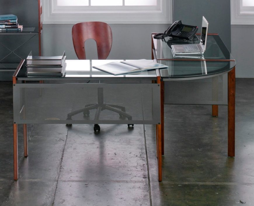 Glass surfaces add a boldly modern touch to any desk. Paired with wood or metal construction, the glass expands visual space and lightens the entire piece of furniture. Often removable for cleaning, maintenance, or moving purposes, glass desktops can be found in a variety of shapes and configurations.