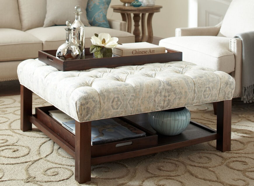 Tufted Fabric Ottoman With Exposed Wood Legs.