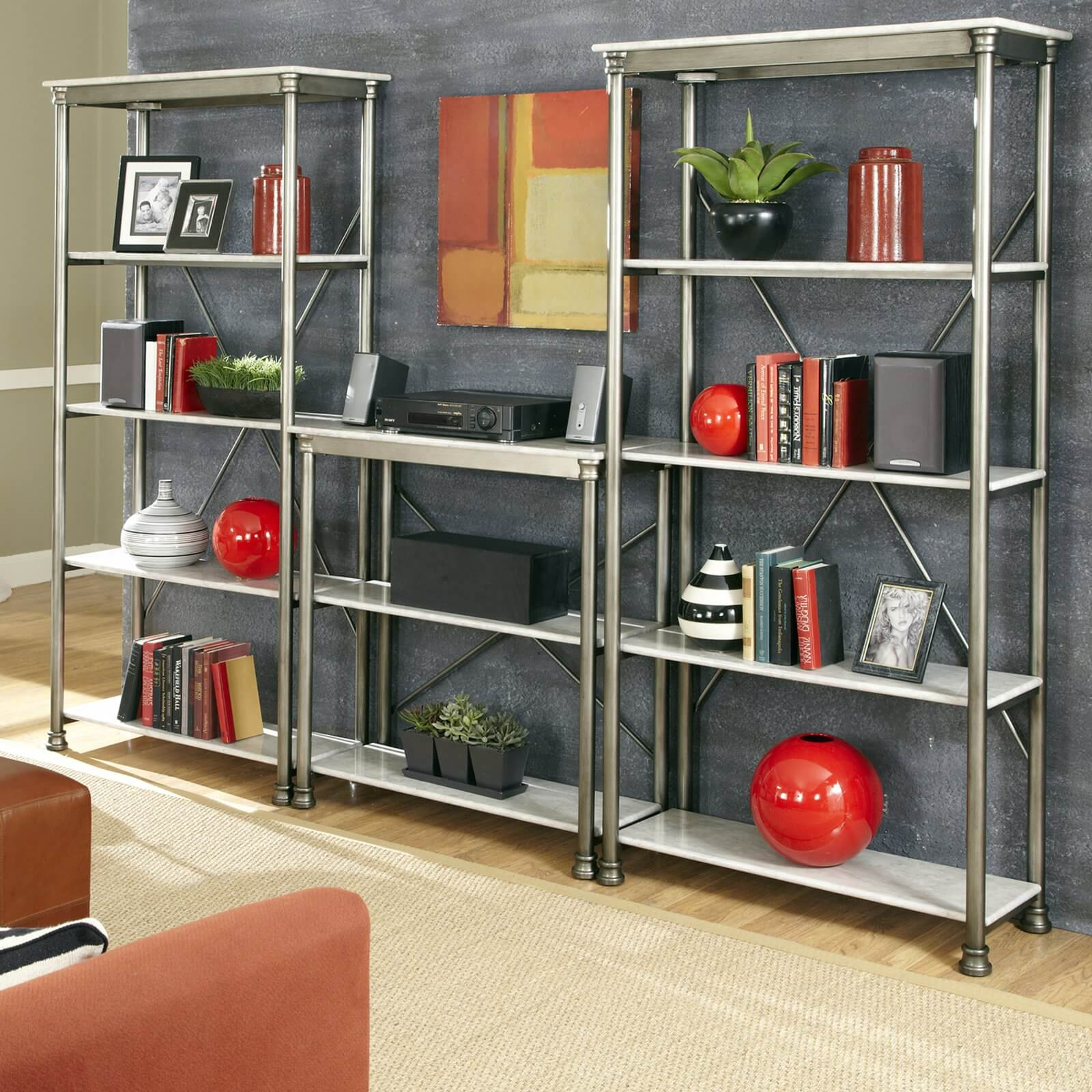 Metal construction allows for lighter weight designs, more shape options, and a look that easily compliments modern or industrial design. Often bookcases with metal frames will still use wood or, in this case, marble shelving.