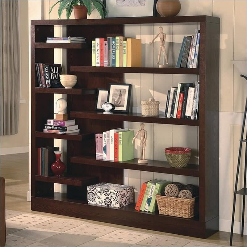 Backless Bookshelves ... focusing on often minimalistic yet eye catching shapes. Novel  configurations are common, like the asymmetrical, backless design featured  here.