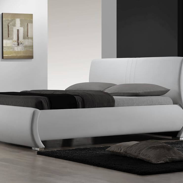 a platform bed has a base which consists of a raised level horizontal solid frame