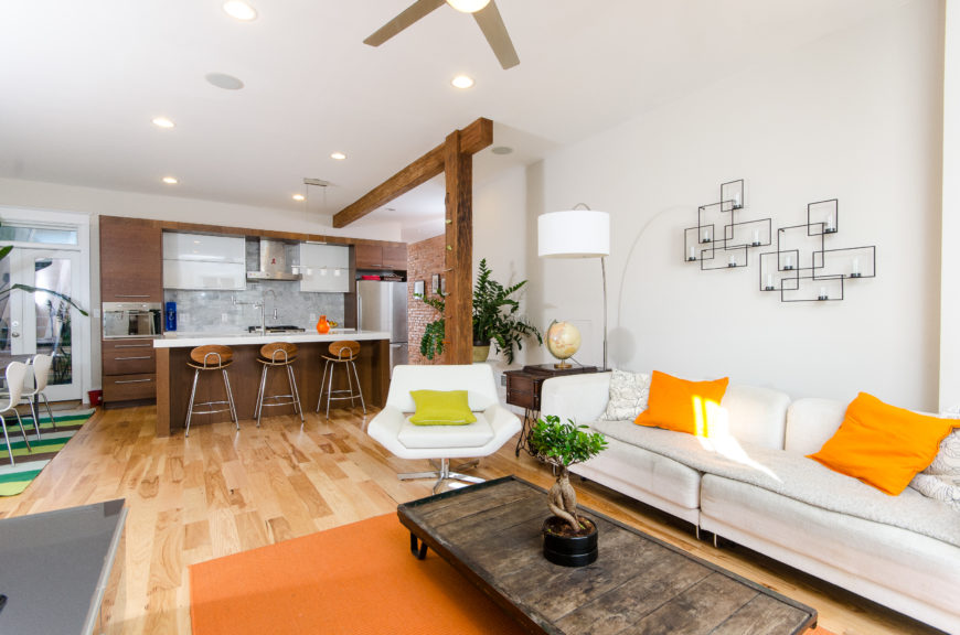 Like its neighbor, the Adrienne condo's main living space is open, with access to the kitchen and dining room coming off the main hallway entrance.