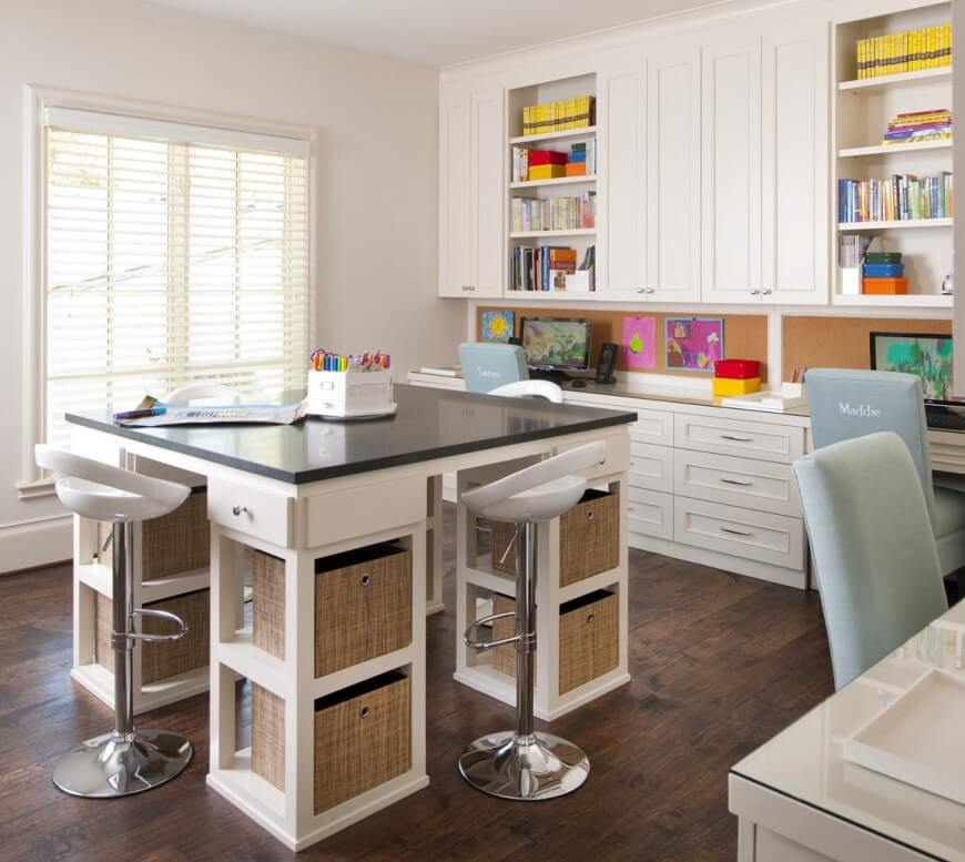 This multi-purpose home office has three workstations, each with their own computer and personalized chairs. The back of the desk is lined with cork board. The large table in the center of the room has fabric drawers for storage and four stools--perfect for arts and crafts projects that require more room than the desk can provide.