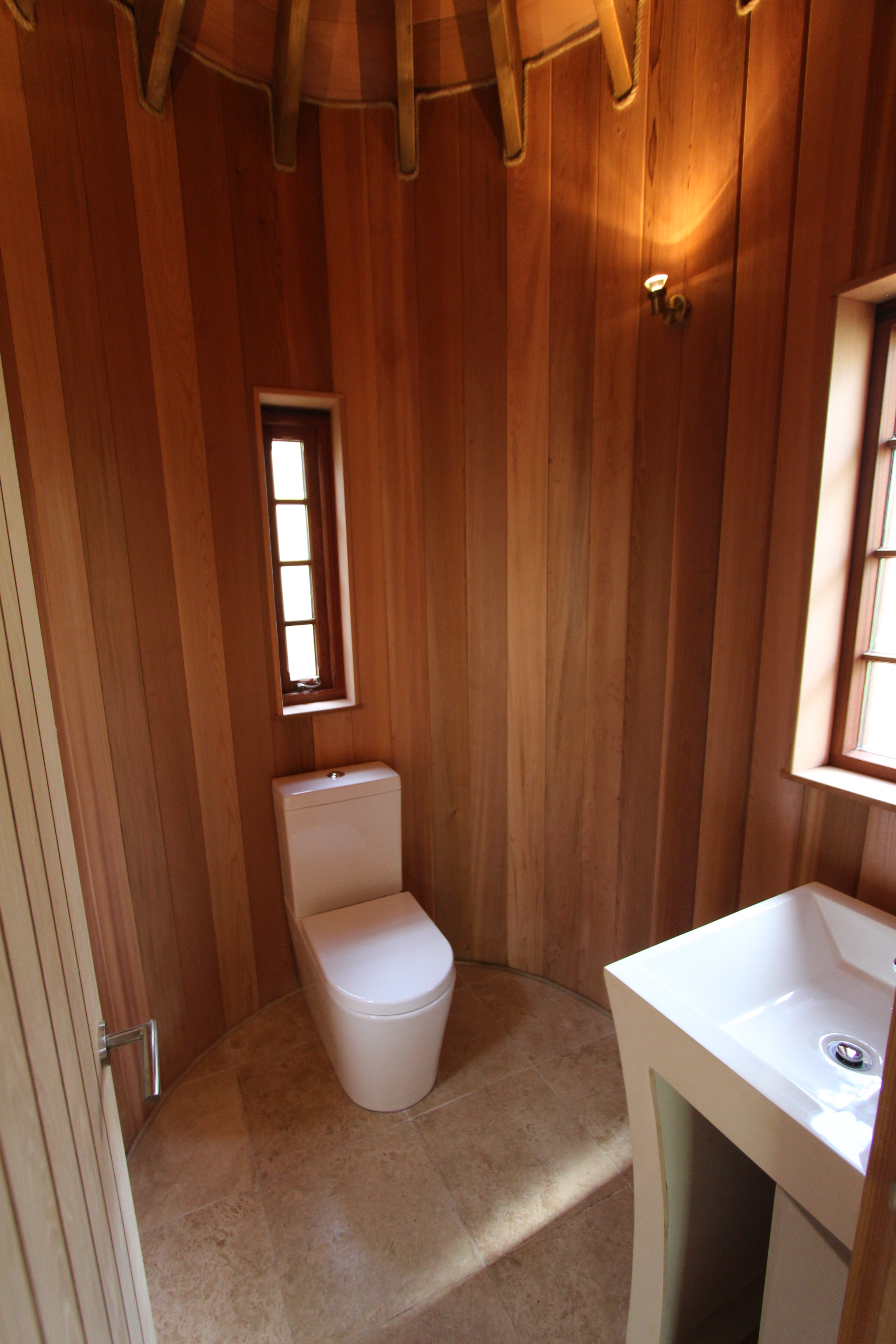 The small bathroom is just off the main sitting area and home theatre.