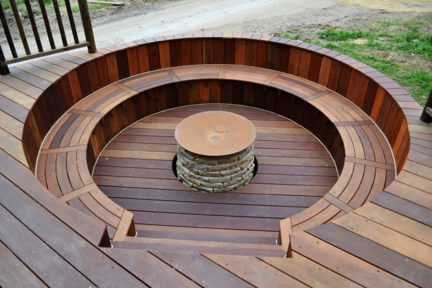 Here is the fire pit in close view, with the stone pit itself surrounded by circular rich oak bench seating.