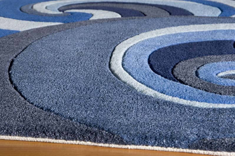 Acrylic is a plastic based material, often found in modern carpets and rugs. The fibers are stain resistant, strong, and can be dyed and patterned like cotton or wool.