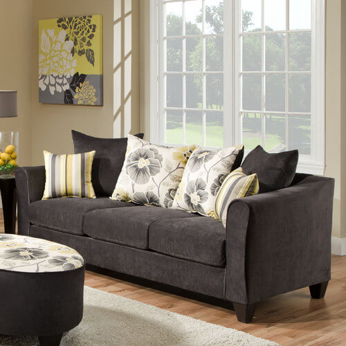 This suede sofa has sturdy exposed legs that add a bit of polish to the piece. The included throw pillows add a fun contrast to the pewter upholstery. This sofa is simple elegance in a soft, plush package.