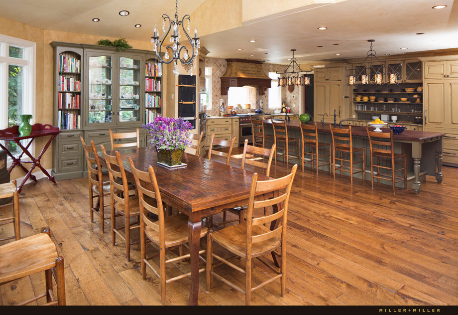 The large breakfast area is not far from the kitchen and is situated next to multiple windows that look out on the garden. A large built-in china cabinet with bookcases dominates the far wall.