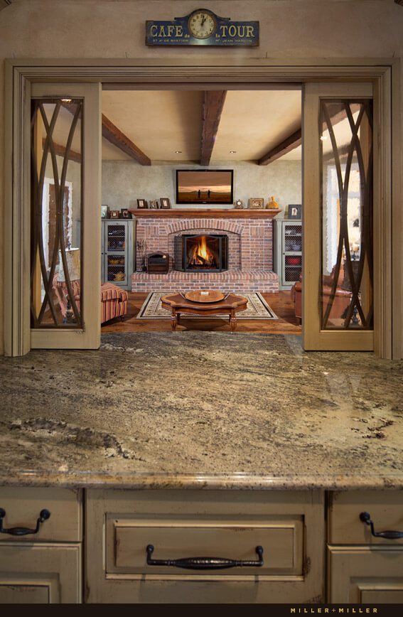 A pass through from the kitchen to the family room makes for easy entertaining. The white oak wooden floors continue into the living room.