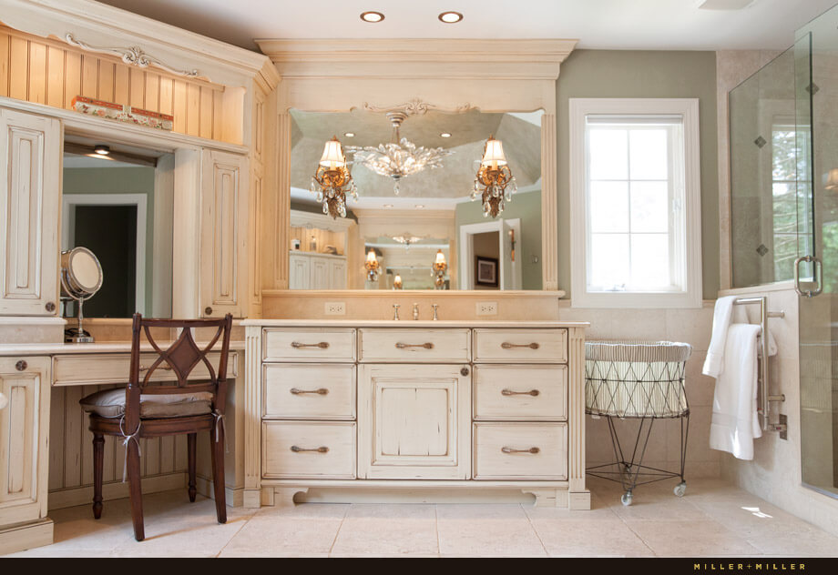 The makeup table has plenty of storage and sits nearby one of the vanities.