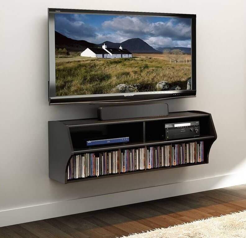 The floating design is a wall-mounted unit that allows for completely open floor space and a clean, unobtrusive look. These contain shelving and, often, cord concealment. TVs can be stood on top, or wall-mounted themselves above the floating stand.