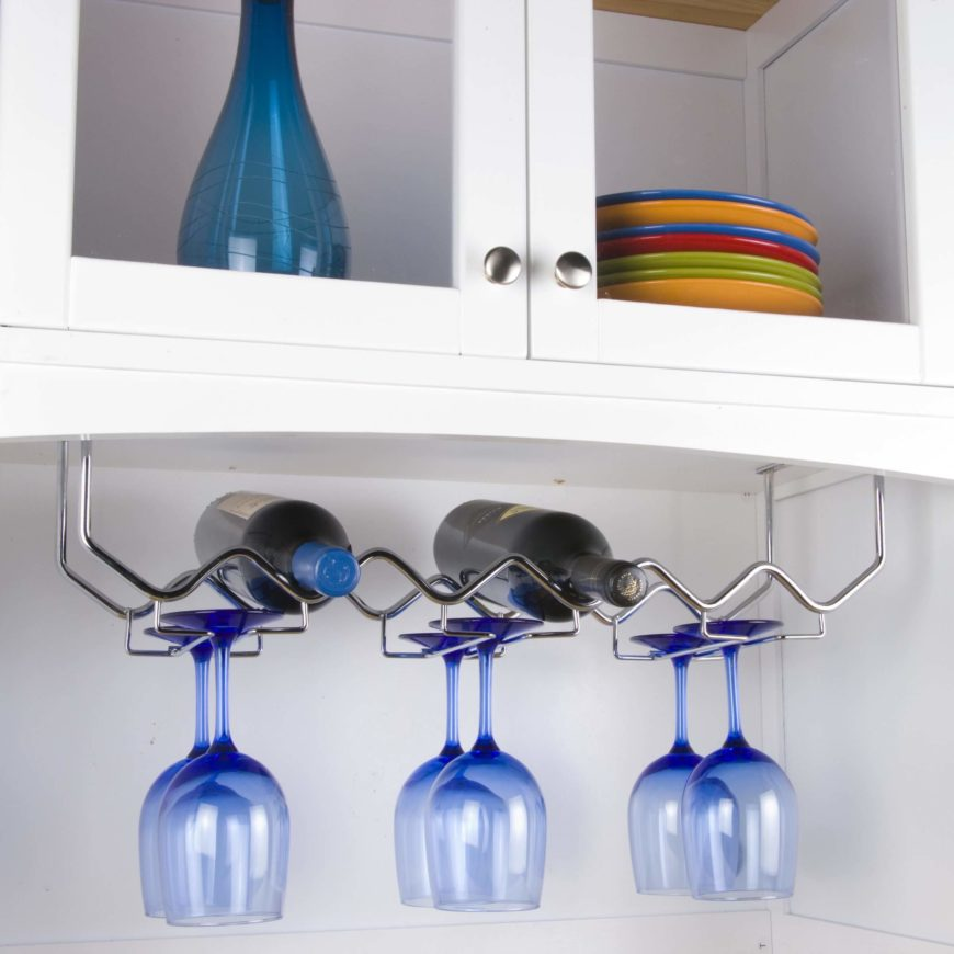 Hanging wine racks are another perfect way to conserve space. This first model is mounted beneath cabinetry, and with its simple wire frame, holds both bottles and glassware.