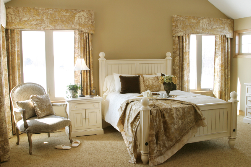 This Traditional White Bedroom Carries The Patterns Of The Curtains Into The Throw Pillows Blanket
