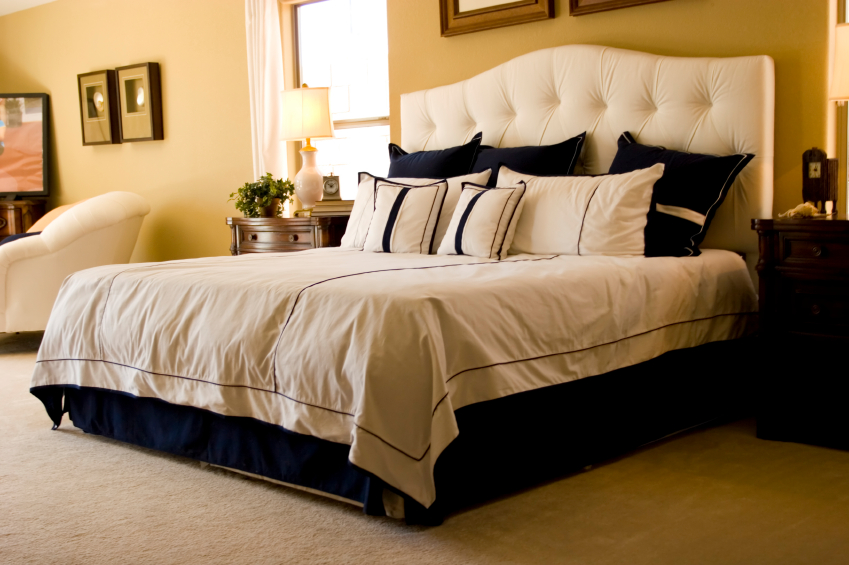 This Contemporary Bedroom Combines Neutral Walls And Carpeting With Deep Blue Accents Just Off To