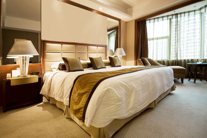 The enormous bed dominates this room. Brown and white molding adds an elegant touch.