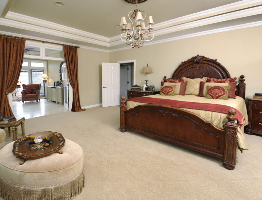 Curtains can be used to separate the carpeted master bedroom from a smaller seating area just through an archway.