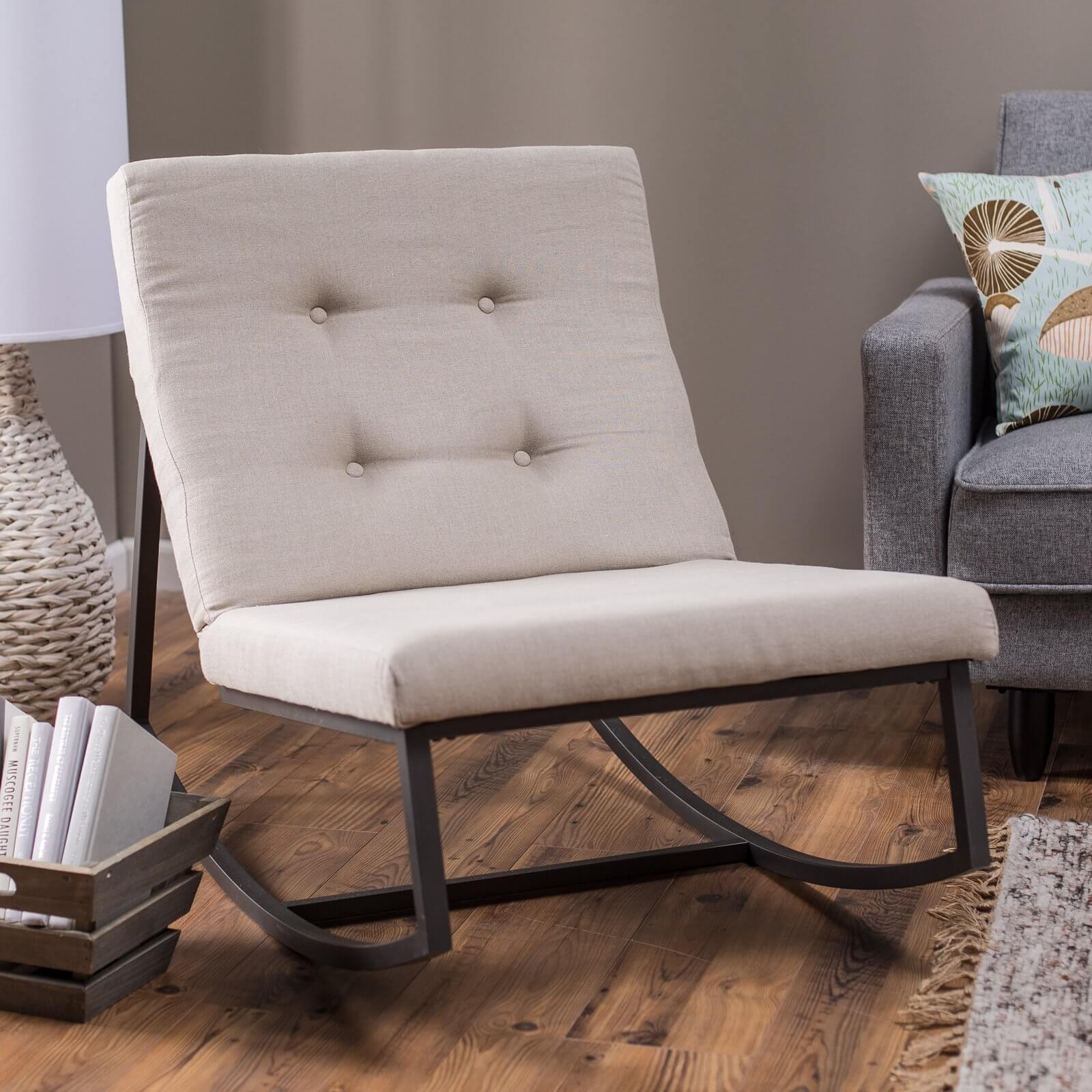 While most rocking chairs feature a simple, direct design with a wooden frame and bare seat, there are a multitude of upholstered models to choose from. We have shared an armless contemporary example here, with button tufted plush back.