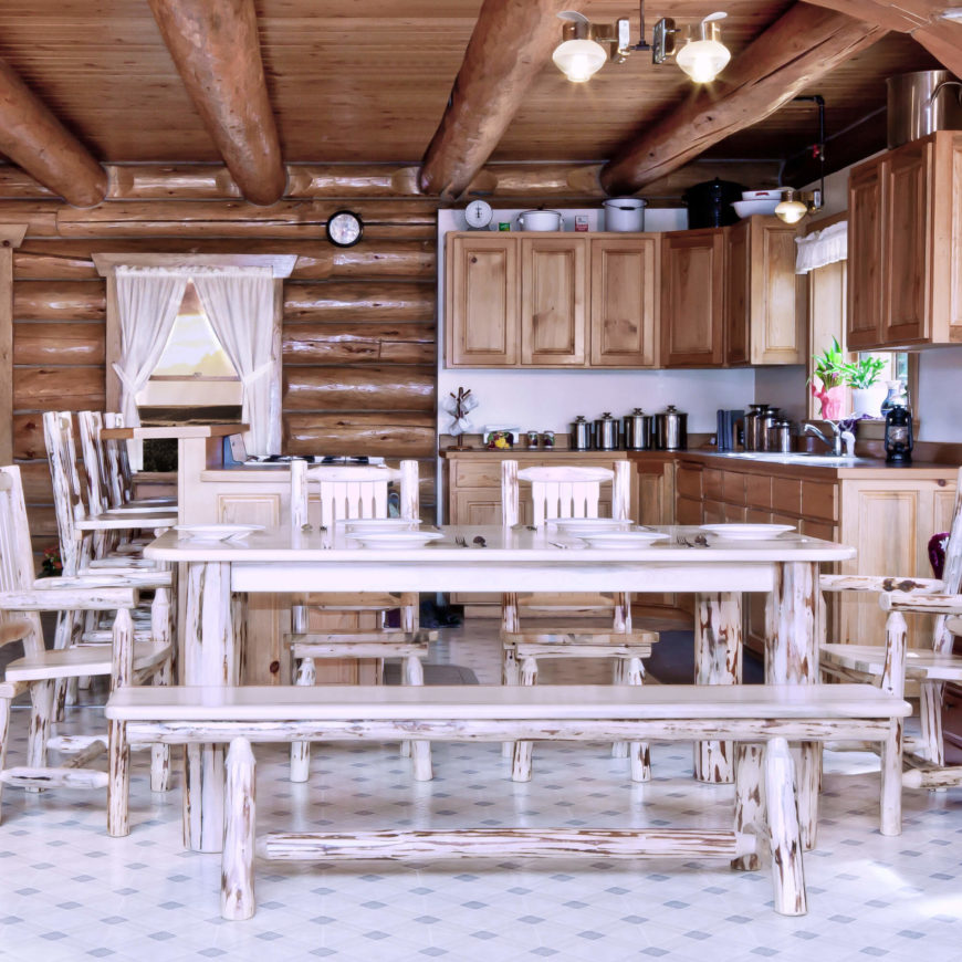 Rustic style utilizes unpainted wood in more natural, hand-carved shapes for a simplistic, back-to-nature feel that is popular in cabins and cottages across the country. Our featured example has a rounded log-style frame beneath a soft edged flat table top.