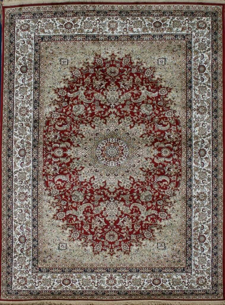 Silk gives a soft and luxurious touch to any piece of furniture it's woven into. This particular rug features an intricate pattern in rectangle form.