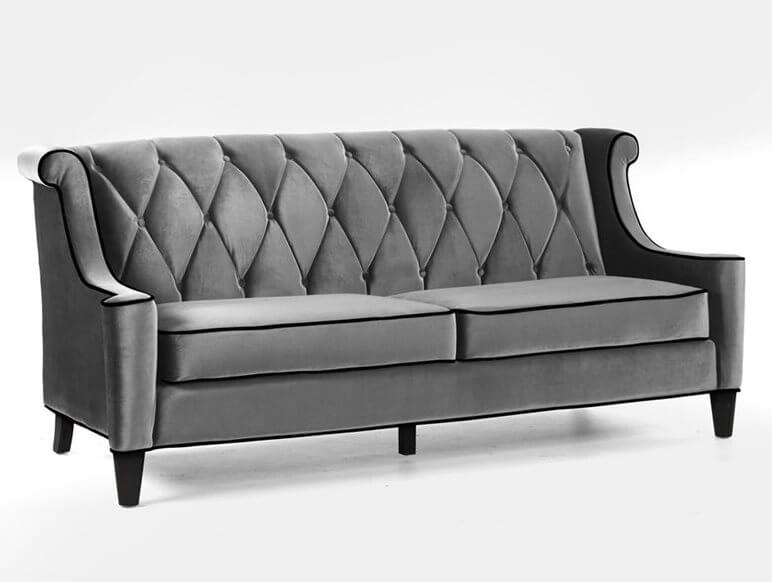 Grey velvet with black piping makes this deep-seated sofa something you'll want to cuddle up in at the end of a long day. The high tufted backrest adds additional comfort.