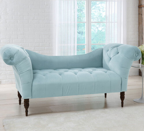This soft, elegant love seat with tufted seating and rolled arms has an elegant silhouette and a rich expresso finish on the legs. While not as large as other sofas in this collection, this is definitely an inviting seating option for one or two.
