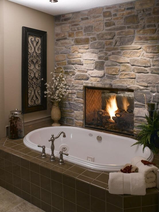 Nice This Rustic Feel Bathroom Houses A Stone Fireplace And Brown Tile Wrapped  Soaking Tub In Cozy