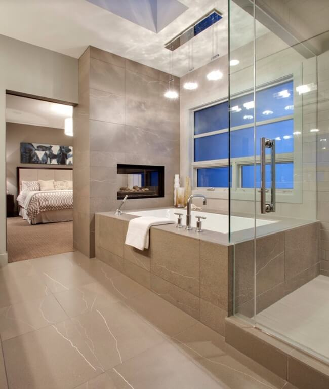 This Ultra Modern En Suite Holds A Grey Tile Covered Bathroom In Which A  Glass