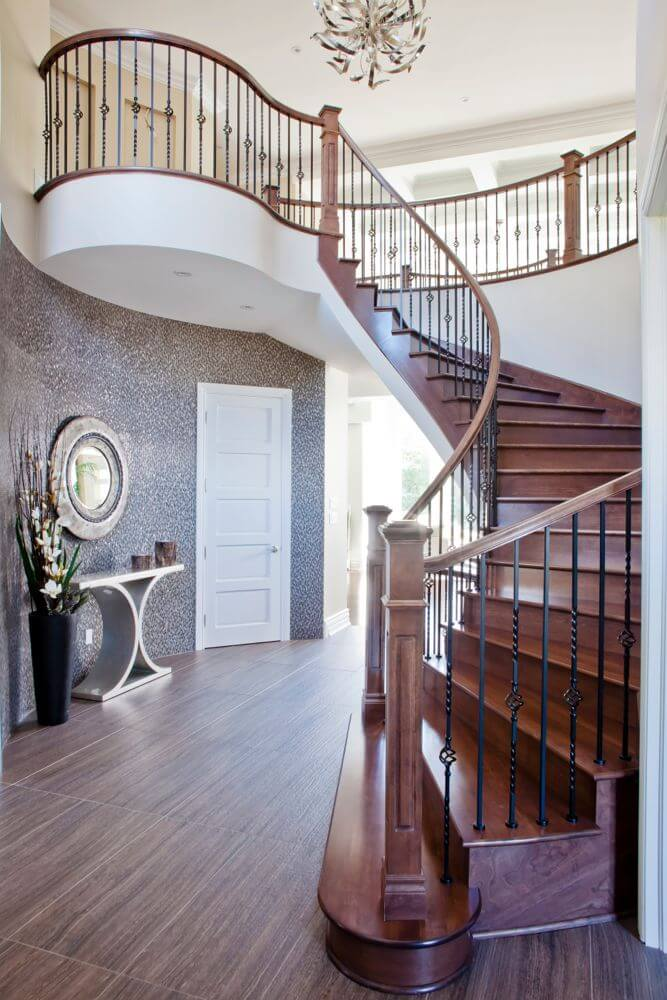 this contemporary foyer has floors with a distinctive wood grain polished cherry wood stair treads - Foyer Tile Design Ideas